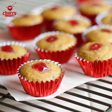 Bitesized cherry chia mini muffins in mini red cupcake liners.