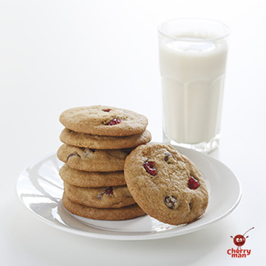 A stack of chocolate cherry cookies served with cold milk.