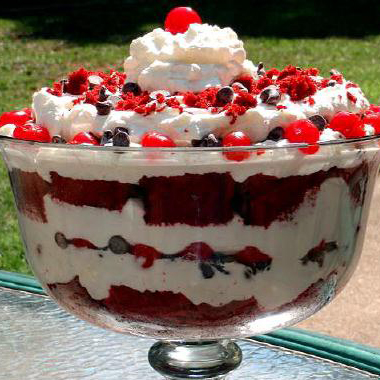 Cherry red velvet trifle with layers of cake and whipping cream