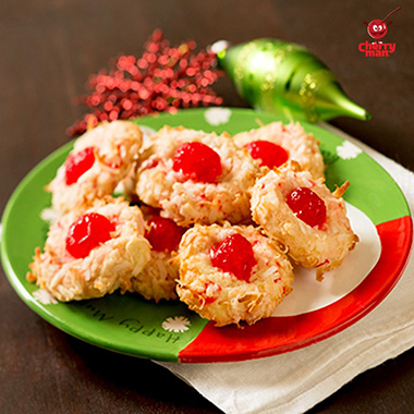 Sweet maraschino cherry and coconut cookies served on santa plate