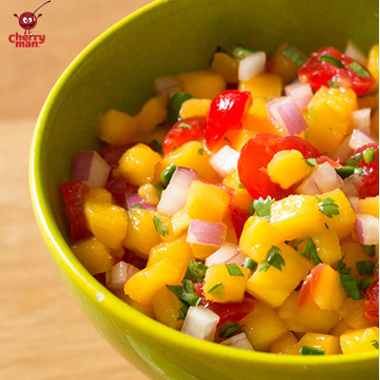 Maraschino cherry and mango salsa with onions and pepper