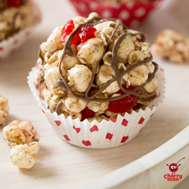 Maraschino cherry popcorn balls in red polka dot cupcake liner