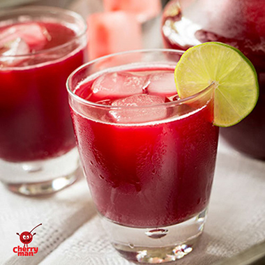 Holiday punch beverage setting with cherry ice cubes