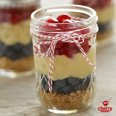 healthy homemade pudding parfait with layers of blueberries and cherries.